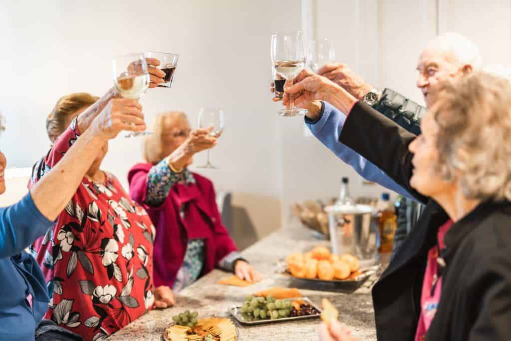 Senior group at party toasting wine glasses