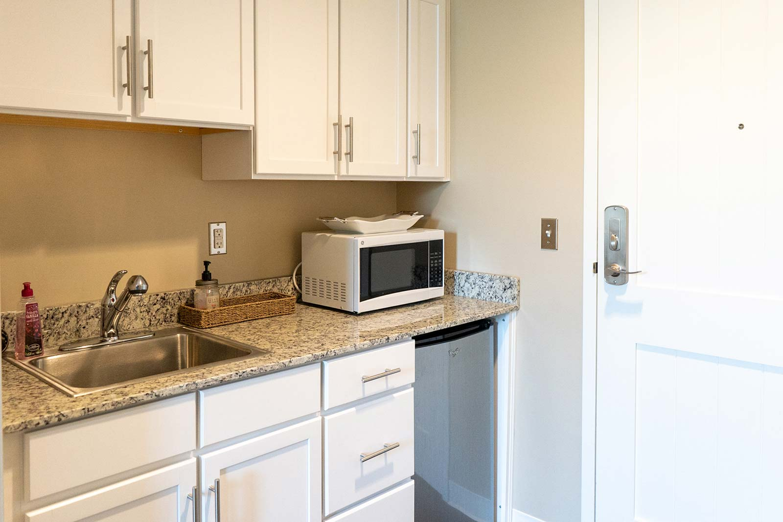 Assisted living apartment kitchenette at The Arbors of Gulf Breeze in Gulf Breeze, FL